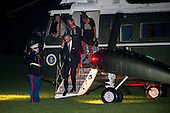 United States President Barack Obama salutes the Marine Guard as he and daughters Malia and Sasha disembark Marine One on the South Lawn of the White House in Washington, District of Columbia, U.S., on Sunday, August 31, 2014. The First Family traveled to Westchester County, New York to attend the wedding of senior policy advisor for nutrition policy and Let's Move Executive Director, Sam Kass to MSNBC host Alex Wagner. <br /> Credit: Pete Marovich / Pool via CNP