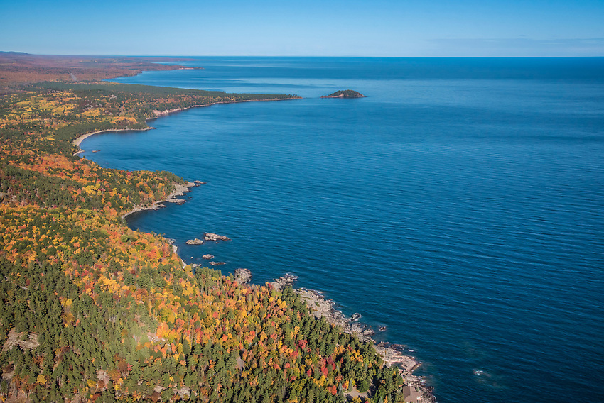 Aerial photography of  the rugged Lake Superior shoreline north of Marquette, Michigan during fall color season. Areas shown include Wetmore Landing Beach and Little Presque Isle.