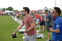 NWA Democrat-Gazette/BEN GOFF @NWABENGOFF<br /> Vincent Tran (right) and teammate Todd Jackson, both with Advanced Solutions, compete Friday, June 16, 2017, during the Catfish, Corndogs and Cornhole tournament at Mercy Hospital in Rogers. The event is an annual fundraiser hosted by WhyteSpyder, with proceeds from this year's tournament benefiting Mercy Health Foundation. Some 140 teams of two entered this year, according to WhyteSpyder CEO Eric Howerton.