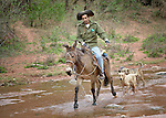 A man rides a horse through the Guarani indigenous village of Kapiguasuti, Bolivia.