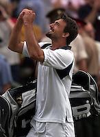 WIMBLEDON CHAMPIONSHIPS 2001 08/07/01 MENS SEMI-FINAL GORAN IVANISEVIC (CROATIA) GORAN IVANISEVIC CELEBRATES AS HE BEATS TIM HENMAN PHOTO ROGER PARKER