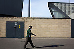 An away fan making his way to the turnstiles after arriving at the Globe Arena before Morecambe hosted Plymouth Argyle in a League 2 fixture. The stadium was opened in 2010 and replaced Morecambe's traditional home of Christie Park which had been their home since 1921, the year after their foundation. Plymouth won this fixture by 2-0 watched by 2,081 spectators, in a game delayed by 30 minutes due to traffic congestion affecting travelling Argyle fans.
