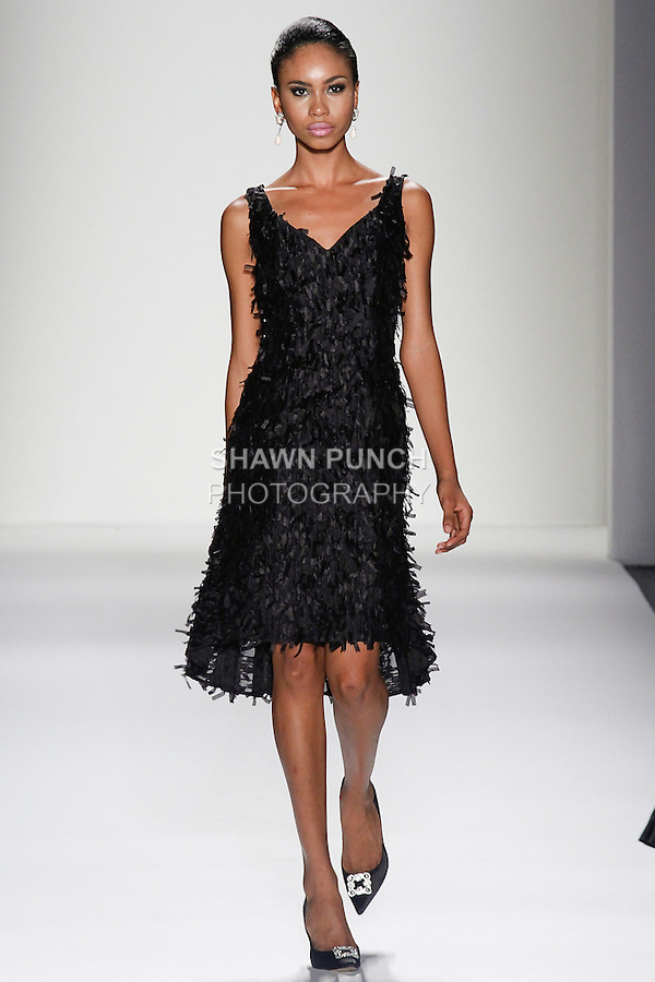 Model walks runway in a dress from the Black Floral Fantasy collection, during the b michael AMERICA Couture Spring 2014 fashion show, at Mercedes-Benz Fashion Week Spring 2014 in New York, on September 11, 2013.