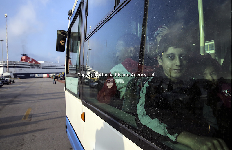 Pictured: A young boy on the bus that will take him to a refugee camp Friday 26 February 2016<br /> Re: Hundreds of refugees that crossed the border from Turkey to the Greek islands, have arrived at the port of Piraeus near Athens, Greece