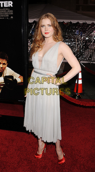 "AMY ADAMS.arriving at the Los Angeles premiere of ""The Fighter"" at Grauman's Chinese Theater in Hollywood, California, USA, December 6th, 2010..full length grey gray sleeveless dress hand on hip mid red silk satin shoes beige mesh platform .CAP/ROT/TM.©TM/Roth Stock/Capital Pictures"