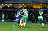 Adebayo Akinfenwa of Wycombe Wanderers & Ryan Dickson of Yeovil Town during the Sky Bet League 2 match between Wycombe Wanderers and Yeovil Town at Adams Park, High Wycombe, England on 14 January 2017. Photo by Andy Rowland / PRiME Media Images.