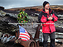 03/11/14<br /> <br /> Pete Jozefczyk , from Glossop Mountain Rescue, lays a wreath and places the American flag on wreckage at a crash site where thirteen airmen were killed when their bomber hit remote moorland high up in the Peak District 66 years ago today.<br /> <br /> Amazingly, the area on Bleaklow Moor is so remote that many of the aircraft's twisted remains, including at least two of engines from the B29 Superfortress still litter the site today.<br /> <br /> The American bomber, known as 'Over-Exposed!' had been converted into a photo reconnaissance aircraft.<br /> <br /> In some of its earlier flights it had been used to photograph the nuclear bomb tests at Bikini Atoll in the Pacific Ocean and had also taken part in the Berlin airlift.<br /> Captain Landon P. Tanner took off on the morning of 3rd November 1948, at around 10.15 from Scampton, Lincolnshire heading on a routine flight to Burtonwood USAF base in Warrington. The B29 was carrying USAF wages among other things. The crew were due to return to the States in a few days.<br /> When 'Over Exposed!' failed to arrive at Burtonwood an air search was initiated, and that afternoon blazing wreckage was spotted high on the moors near Higher Shelf Stones. By chance members of the Harpur Hill RAF Mountain Rescue Unit were just finishing an exercise two and a half miles away, so they quickly made their way to the scene of the crash but there was clearly nothing that could have been done for any of the crew.<br /> This is just one of 180 military and civilian aircraft that have crashed in and around the Peak District since 1918.<br /> <br /> All Rights Reserved - F Stop Press.  www.fstoppress.com. Tel: +44 (0)1335 300098