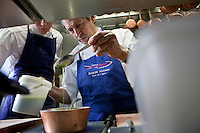 One of his chefs looks on as head chef Jacques Maximin prepares a dish in the kitchen of his restaurant Le Bistro de la Marine, Cagnes sur Mer, France, 07 April 2012
