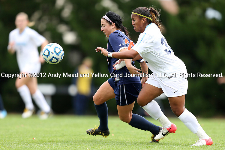 28 October 2012: Virginia's Erica Hollenberg (left) and UNC's Meg Morris (right) chase the ball. The University of North Carolina Tar Heels played the University of Virginia Cavaliers at Fetzer Field in Chapel Hill, North Carolina in a 2012 NCAA Division I Women's Soccer game. Virginia defeated UNC 1-0 in their Atlantic Coast Conference quarterfinal match.