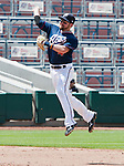 Reno Aces second baseman Taylor Harbin leaps high in the air to throw the ball to first during their game against the Las Vegas 51s played on Sunday afternoon, July 1, 2012 in Reno, Nevada.