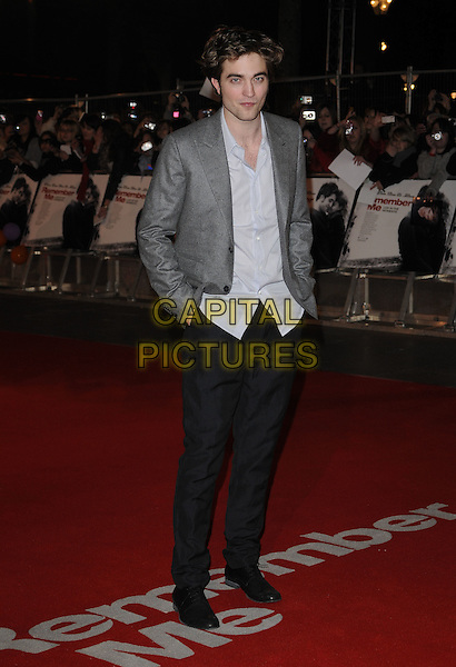 """ROBERT PATTINSON.""""Remember Me"""" UK Film Premiere - Arrivals held at Odeon cinema, Leicester Square, London, England..March 17th 2010 .full length grey gray blazer jacket blue shirt hands in pockets white trousers black rob.CAP/CAN.©Can Nguyen/Capital Pictures."""
