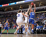 SIOUX FALLS, SD - MARCH 5:  Allyson Bunch #33 from IPFW spots up for a jumper over Madison Guebert #11 and Clarissa Ober #21 from South Dakota State during the Summit League Basketball Championship Saturday in Sioux Falls.  (Photo by Dave Eggen/Inertia)