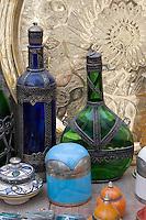 Tripoli, Libya - Antique Glassware, Cosmetic Jars, Copper Market (Suq al-Ghizdir), Tripoli Medina (Old City).  Bottles, Metal Trays.