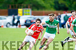 David O'Callaghan, St Pats, tries to get away from Legions Billy McGuire when the sides met in Blennerville last Saturday evening in the senior football league Div 2 match.