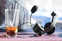 An almost-empty diet cola and his broadcast headphones and mic rest on the table during a break as Scott Zolak takes part in the Zolak and Bertrand radio show, a weekly New England sports radio afternoon broadcast on 98.5 The Sports Hub, at the CBS Scene Restaurant and Bar at Patriot Place next to Gillette Stadium in Foxoborough, Mass., USA, on Wed., Jan. 24, 2018. Zolak is a former backup quarterback for the New England Patriots football team and is the Patriots' radio color commentator. Zolak's partner for the show is Marc Bertrand, and they've been broadcasting together for about 3 years. During this broadcast, Zolak and Bertrand talked about their plans to go to the upcoming Super Bowl, ticket prices for the Super Bowl, and had an interview with Boston Celtics Head Coach Brad Stevens.