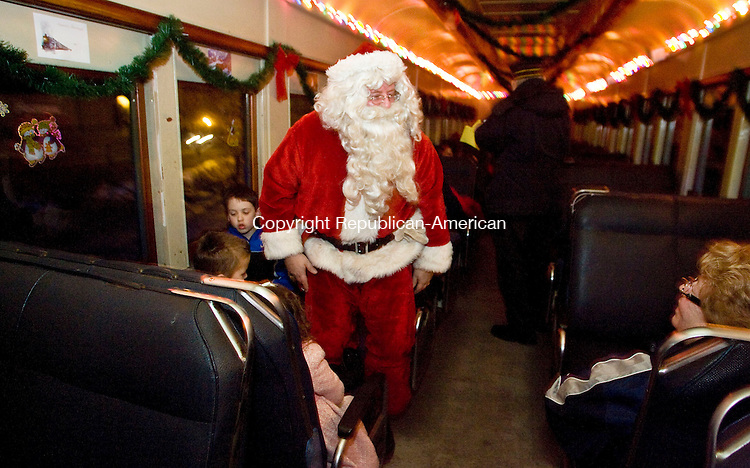 THOMASTON, CT - 18 DECEMBER 2009 -121809JT01--<br /> Santa Claus walks through the Northern Lights Express as he boarded the train from Santa's Train Workshop, which was near the Railroad Museum of New England in Thomaston on Friday. The train left from the Railroad Museum, picked up Santa at the Train Workshop, and traveled into Watertown until reversing back to Thomaston. The rides will continue today and Sunday, and next week from Friday through Sunday.<br /> Josalee Thrift Republican-American