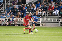 Kansas City, Mo. - Saturday April 23, 2016: Portland Thorns FC forward Hayley Raso (21) and FC Kansas City midfielder Mandy Laddish (7) chase down the ball during a match at Swope Soccer Village. The match ended in a 1-1 draw.