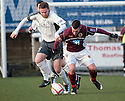 Stranraer's Michael Dunlop and Stenny's Stewart Kean challenge for the ball.