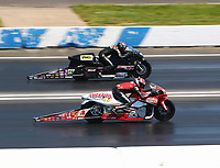 Jun 11, 2017; Englishtown , NJ, USA; NHRA pro stock motorcycle rider Hector Arana Jr (near) alongside Karen Stoffer during the Summernationals at Old Bridge Township Raceway Park. Mandatory Credit: Mark J. Rebilas-USA TODAY Sports