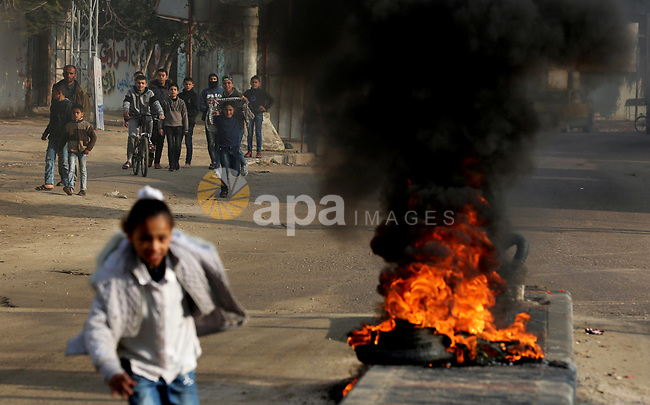 """Palestinian students burn tyres during a protest against US President Donald Trump's expected peace plan proposal or Deal of the Century, in Khan Younis in the southern of Gaza strip on January 29, 2020. Donald Trump has launched his """"ultimate deal"""" for Middle East peace, saying his detailed 80-page plan would be a """"realistic two-state solution"""" that had already been agreed to by Israel. Photo by Ashraf Amra"""
