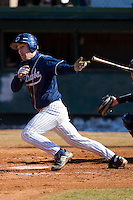 Craige Lyerly #16 of the Catawba Indians follows through on his swing versus the Shippensburg Red Raiders February 14, 2010 in Salisbury, North Carolina.  Photo by Brian Westerholt / Four Seam Images
