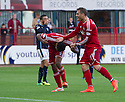 Aberdeen's Shaleum Logan (2) celebrates with David Goodwillie after Dundee's James McPake knocks the ball into his own net,  to put Dundee 2-1 up.