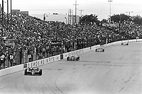 WEST ALLIS, WI - JUNE 2: Mario Andretti drives the Newman Haas Racing Lola T900/Cosworth en route to victory in the Miller American 200 CART IndyCar race at the Milwaukee Mile oval track in West Allis, Wisconsin, on June 2, 1985.