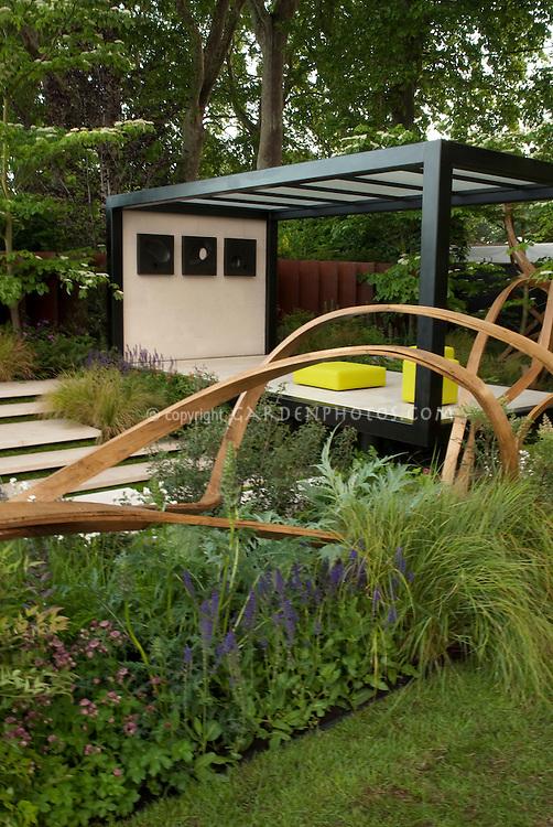 Modern Gazebo & Wooden fence sculpture in garden designed by Andy Sturgeon