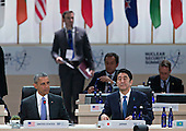 "United States President Barack Obama, left, and Shinzo Abe, Japan's prime minister, wait to begin an opening plenary entitled ""National Actions to Enhance Nuclear Security"" at the Nuclear Security Summit in Washington, D.C., U.S., on Friday, April 1, 2016. After a spate of terrorist attacks from Europe to Africa, Obama is rallying international support during the summit for an effort to keep Islamic State and similar groups from obtaining nuclear material and other weapons of mass destruction. <br /> Credit: Andrew Harrer / Pool via CNP"