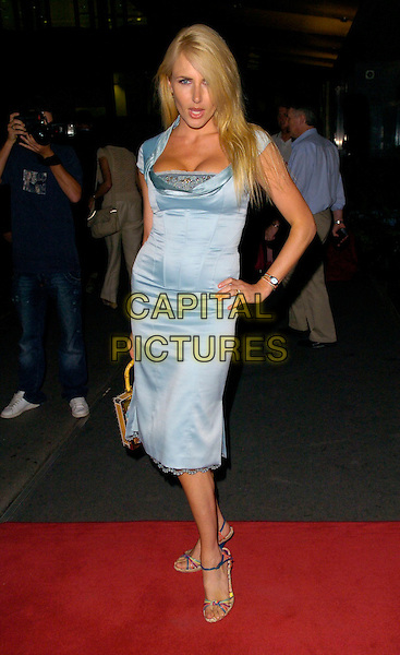 NANCY SORRELL.Comfort Prima High Street Fashion Awards - Arrivals, London Hilton Park Lane Hotel, London, UK..September 12th, 2006.Ref: CAN.full length blue dress satin hand on hip.www.capitalpictures.com.sales@capitalpictures.com.©Can Nguyen/Capital Pictures