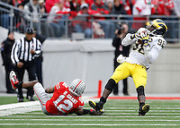 Ohio State Buckeyes cornerback Doran Grant (12) tackles Michigan Wolverines quarterback Devin Gardner (98) during the 4th quarter of the NCAA football game at Ohio Stadium on Nov. 29, 2014. (Adam Cairns / The Columbus Dispatch)
