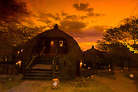 The sunsets behind bomas (guest cottages), Serengeti Serena Lodge, Serengeti National Park, Tanzania