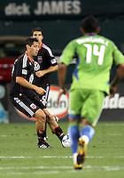 Branko Boskovic #27 of D.C. United passes the ball in front of Tyrone Marshall #14 of Seattle Sounders FC during an MLS match at RFK Stadium on July 15 2010, in Washington DC.Seattle won 1-0.