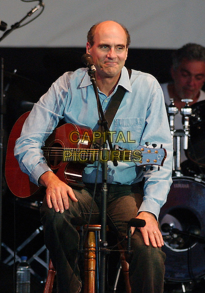 JAMES TAYLOR.Perfrms live in concert during his tour at the Post-Gazette Pavilion, Pittsburgh, PA, USA, .July 9, 2005..half length guitar gig.Ref: ADM.www.capitalpictures.com.sales@capitalpictures.com.©Jason Nelson/AdMedia/Capital Pictures.