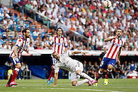 Benzema of Real Madrid and Juanfran and Gabi of Atletico de Madrid during La Liga match between Real Madrid and Atletico de Madrid at Santiago Bernabeu stadium in Madrid, Spain. September 13, 2014. (ALTERPHOTOS/Caro Marin)