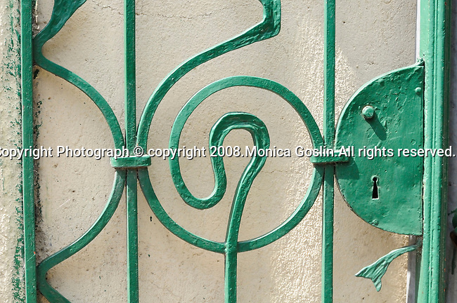 Detail of a green iron gate in the small town of Laglio on Lake Como, Italy.