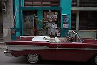 carmin red Bel Air Chevrolet oldtimer, american car in Havana Vieja, Cuba