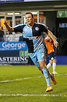 Garry Thompson of Wycombe Wanderers (7) celebrates scoring the opening goal against Luton Town during the Sky Bet League 2 match between Luton Town and Wycombe Wanderers at Kenilworth Road, Luton, England on 26 December 2015. Photo by David Horn.