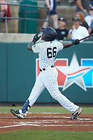 Jordan Scott (66) of the Pulaski Yankees hits a solo home run against the Greeneville Reds at Calfee Park on June 23, 2018 in Pulaski, Virginia. The Reds defeated the Yankees 6-5.  (Brian Westerholt/Four Seam Images)