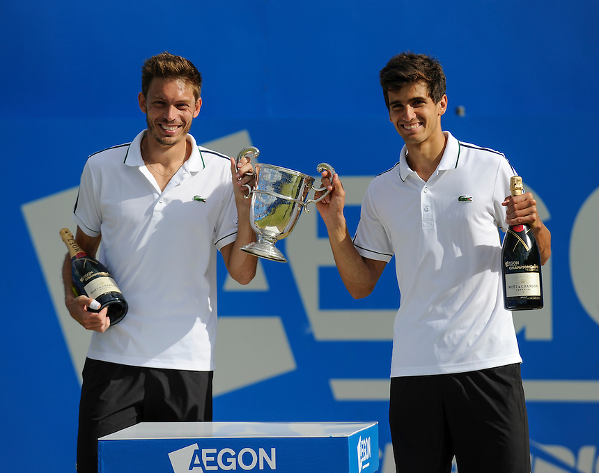 Pierre-Hugues HERBERT (FRA) and Nicolas MAHUT (FRA) with the trophy after their victory over Marcin MATWOWSKI (POL) and Nenad ZIMONJICi (SRB) in the Men&rsquo;s Doubles Final match - Pierre-Hugues HERBERT (FRA) and Nicolas MAHUT (FRA) def Marcin MATWOWSKI (POL) and Nenad ZIMONJICi (SRB) 6-2, 6-2<br /> <br /> Photographer Ashley Western/CameraSport<br /> <br /> Tennis - ATP 500 World Tour - AEGON Championships- Day 7 - Sunday 21st June 2015 - Queen's Club - London <br /> <br /> &copy; CameraSport - 43 Linden Ave. Countesthorpe. Leicester. England. LE8 5PG - Tel: +44 (0) 116 277 4147 - admin@camerasport.com - www.camerasport.com