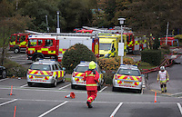 Pictured: Some of the 20 fire engines attending the scene of a large fire at the Gower College Swansea in the Tycoch area of Swansea, Wales, UK. Friday 28 October 2016<br />Re: About 100 firefighters have been tackling a large fire at Gower College Swansea.<br />Mid and West Wales Fire Service was called to Gower College on Tycoch Road, Sketty, just before 4:30am on Friday.<br />It said the fire covered the second and third floors of a four-storey building but it is now under control.<br />There were about 20 fire appliances at the scene, the incident is ongoing and Tycoch Road is shut.