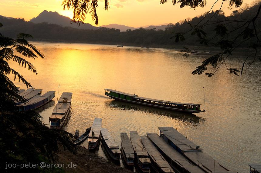boats on Mekong river at sunset time, , Luang Prabang,  Laos, 2012