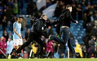 A pitch invader is chased by stewards at the final whistle<br /> <br /> Photographer Rich Linley/CameraSport<br /> <br /> Emirates FA Cup Fourth Round - Manchester City v Burnley - Saturday 26th January 2019 - The Etihad - Manchester<br />  <br /> World Copyright © 2019 CameraSport. All rights reserved. 43 Linden Ave. Countesthorpe. Leicester. England. LE8 5PG - Tel: +44 (0) 116 277 4147 - admin@camerasport.com - www.camerasport.com