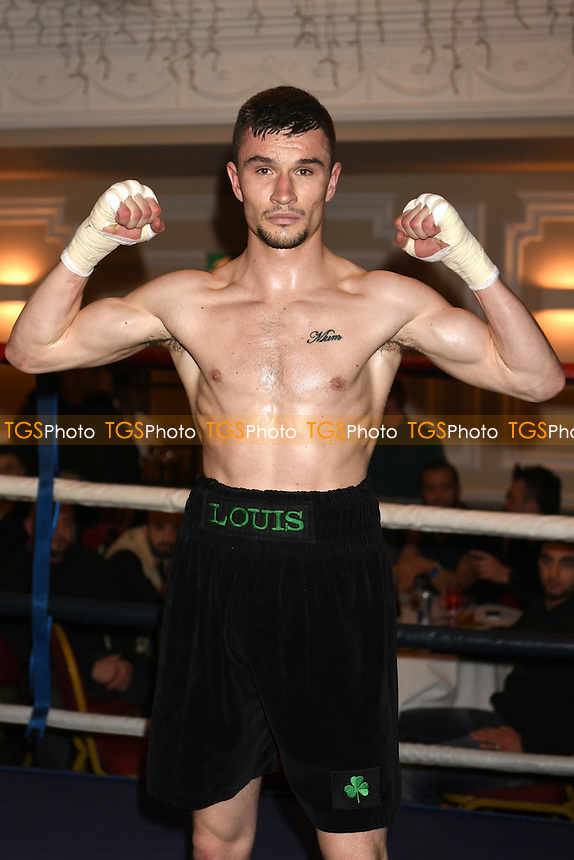 Louis Greene (black shorts) defeats Aleksejs Grustans during a Boxing Show at the Prince Regent Hotel, Chigwell, promoted by JE Promotions