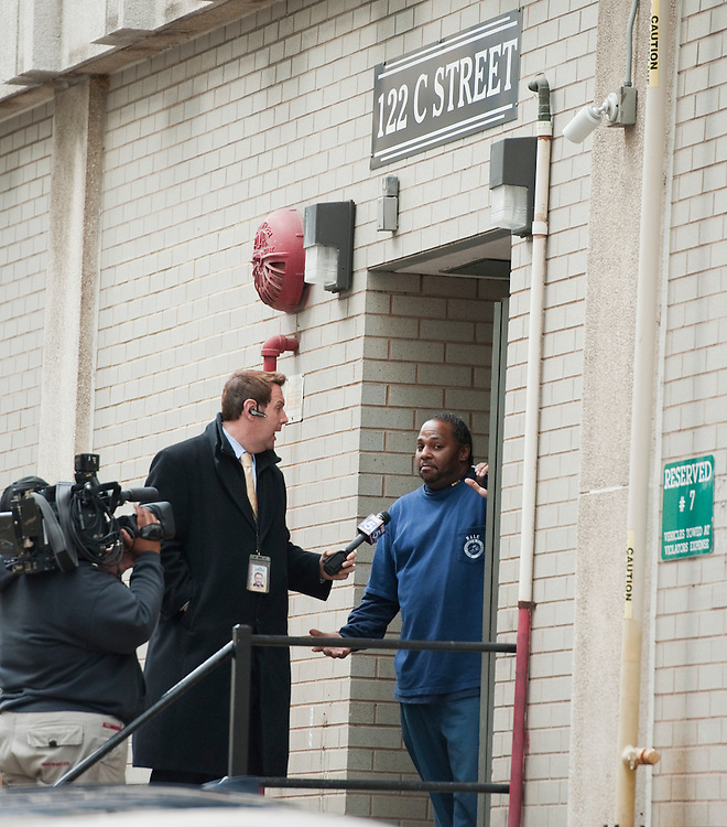 UNITED STATES - FEBRUARY 17:  A television crew interviews an employee of a building in an alley between C St., NW, and Louisiana Avenue, near where a man was arrested who law enforcement officials say was attempting to attack the Capitol.  (Photo By Tom Williams/CQ Roll Call)