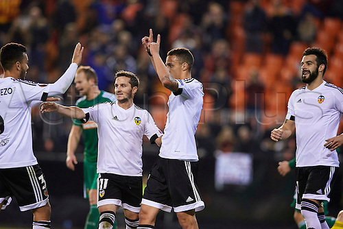 18.02.2016. Mestalla Stadium, Valencia, Spain. Europa League. Valencia versus Rapid Wien. Forward Rodrigo of Valencia CF  (2nd R) celebrates with his team mates after scoring the sixth goal