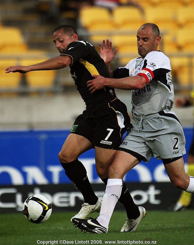 Victory captain Kevin Muscat makes contact with Leo Bertos in the box during the A-League football match between Wellington Phoenix and Melbourne Victory at Westpac Stadium, Wellington, New Zealand on Friday, 28 November 2008. Photo: Dave Lintott / lintottphoto.co.nz