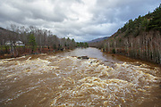 The Pemigewasset River in Woodstock, New Hampshire USA after hours of heavy rains and strong winds from Hurricane Sandy in 2012. Hurricane Sandy caused massive destruction along the east coast.