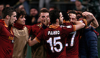 Calcio, quarti di finale di Coppa Italia: Roma vs Juventus. Roma, stadio Olimpico, 21 gennaio 2014.<br /> AS Roma forward Gervinho, of Ivory Coast, third from right, back to camera, celebrates with teammates during the Italian Cup round of eight final football match between AS Roma and Juventus, at Rome's Olympic stadium, 21 January 2014.<br /> UPDATE IMAGES PRESS/Isabella Bonotto