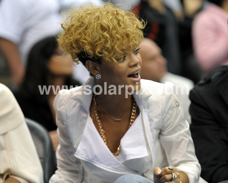 **ALL ROUND PICTURES FROM SOLARPIX.COM**.**SYNDICATION RIGHTS FOR UK, AUSTRALIA, DENMARK, PORTUGAL, S. AFRICA, SPAIN & DUBAI (U.A.E) ONLY**.Rihanna at the 2010 NBA Cleveland Cavaliers and Los Angeles Clippers game at the Staples Center in Los Angeles, USA. 16 January 2010..This pic: Rihanna..JOB REF: 10481 PHZ IOS   DATE: 16_01_2010.**MUST CREDIT SOLARPIX.COM OR DOUBLE FEE WILL BE CHARGED**.**MUST NOTIFY SOLARPIX OF ONLINE USAGE**.**CALL US ON: +34 952 811 768 or LOW RATE FROM UK 0844 617 7637**